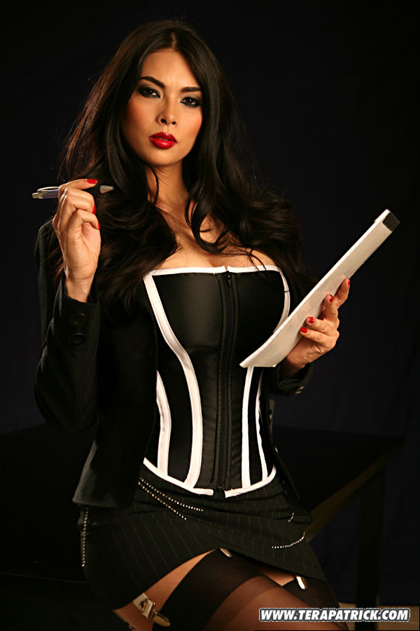 Tera Patrick posing in sexy lingerie and stockings